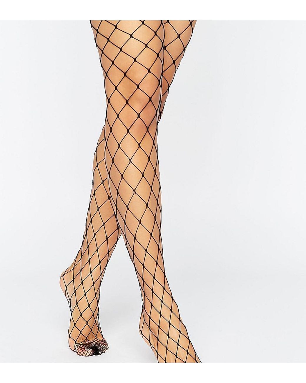 7b2766ca00f23 Long-Touch to Zoom. Long-Touch to Zoom. 1; 2. ASOS - Black 2 Pack Oversized  Fishnet Tights ...
