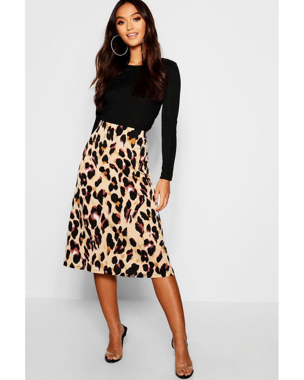 3881e1f52728f Boohoo Petite Leopard Print Bias Cut Midi Skirt in Black - Lyst