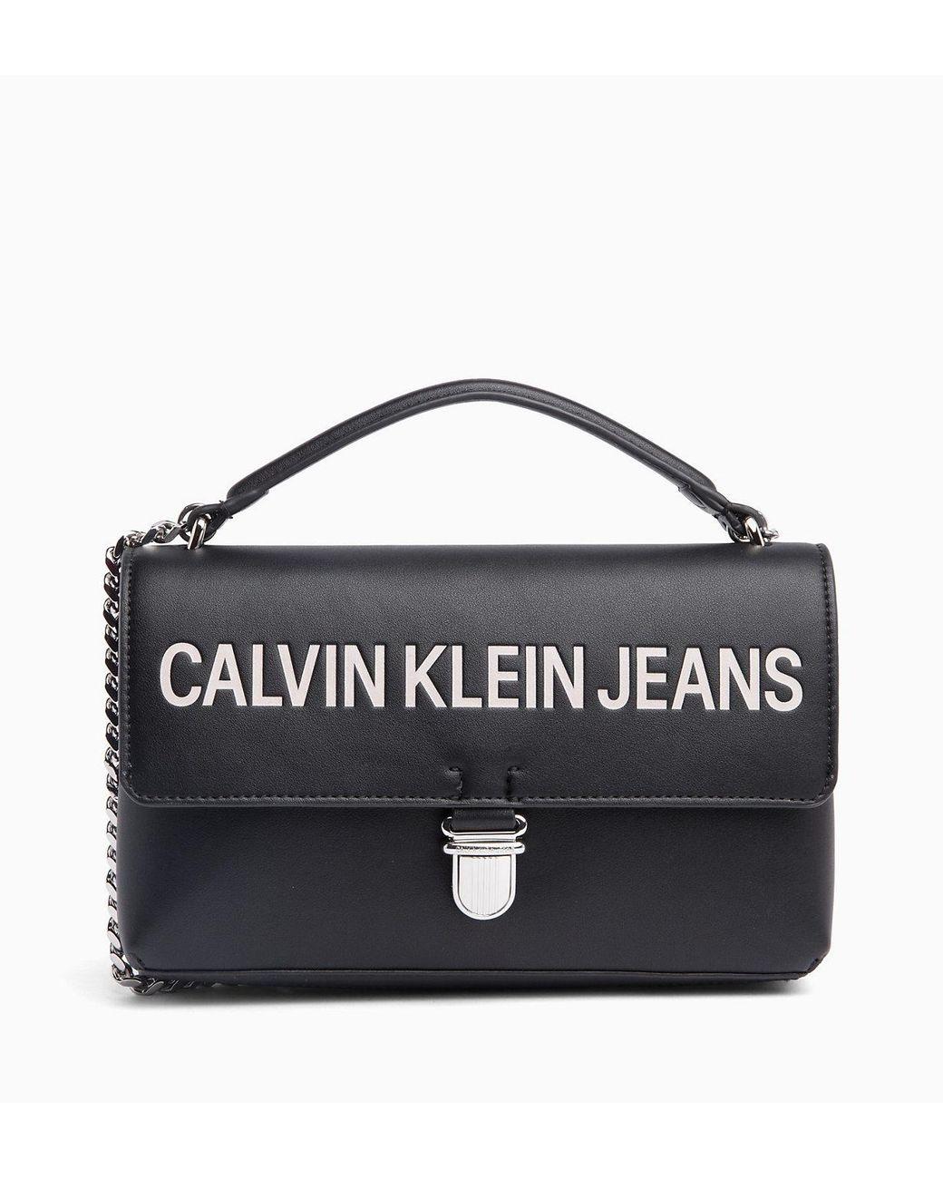 77e48f866de Calvin Klein Logo Flap Cross Body Bag in Black - Lyst