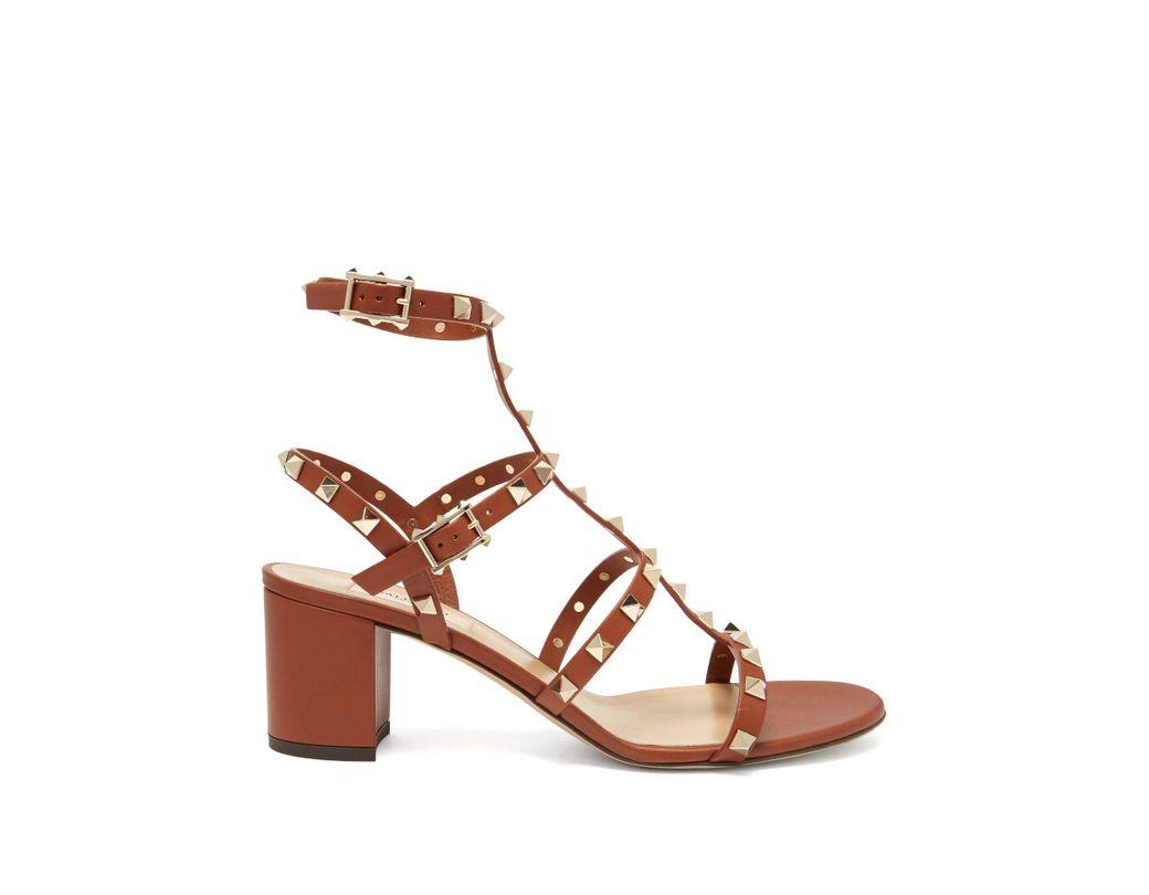 642ec2d33a85 Lyst - Valentino Garavani Rockstud Sandals in Brown