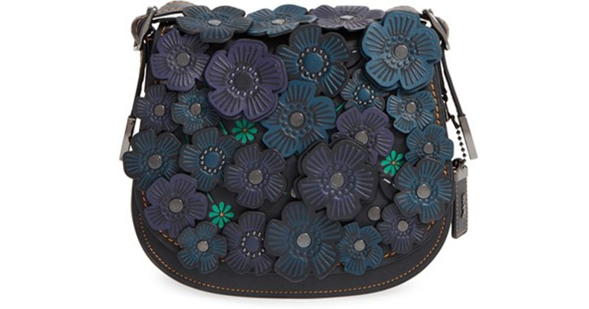 Lyst coach flower applique leather saddle bag in black