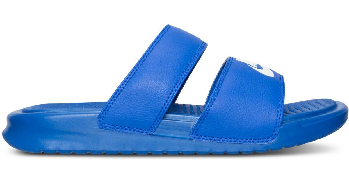 df5532e008aa Lyst - Nike Women s Benassi Duo Ultra Slide Sandals From Finish Line in Blue