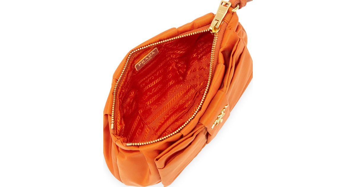 Prada Tessuto Bow Wristlet in Orange | Lyst