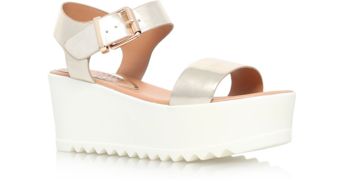 4aa3432a5c3 Miss poppy flat platform sandals in metallic lyst jpeg 1200x630 Gold flat  platform sandals