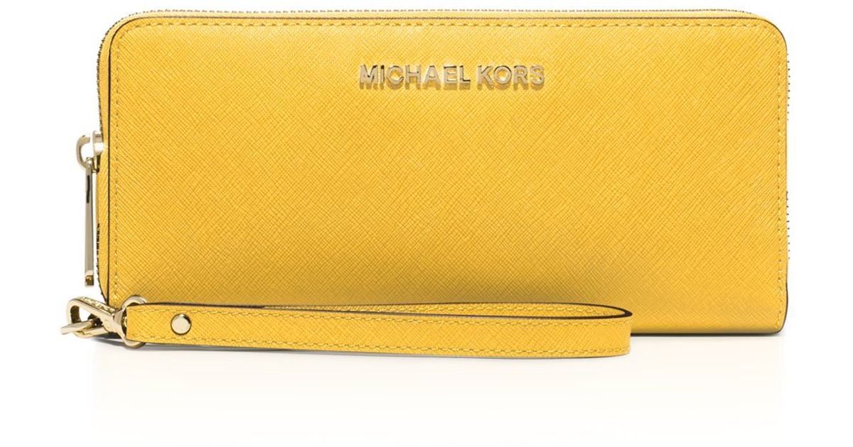 a6133ad49125 ... promo code for lyst michael michael kors wallet jet set travel  continental saffiano in metallic 8b90b