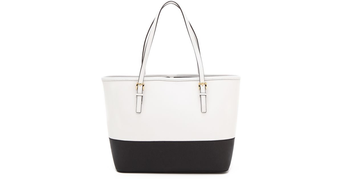5f78db699c91 ... italy lyst michael michael kors jet set small travel tote optic white  black in black 1cd1f