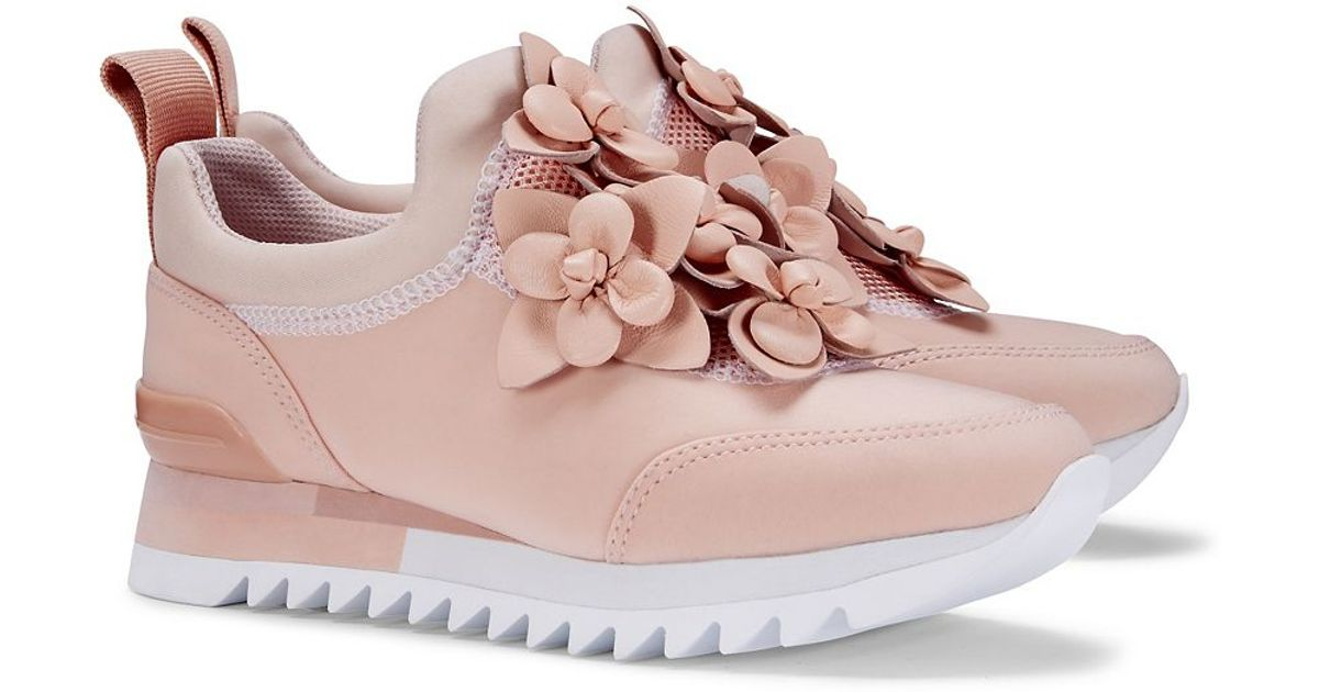 1d14472ed1d30 Lyst - Tory Burch Blossom Sneaker in Pink