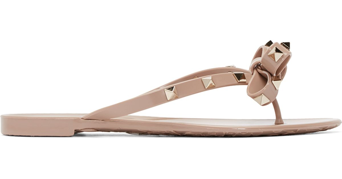 08e5b3243ccc79 Lyst - Valentino Pink Rockstud Bow Sandals in Natural