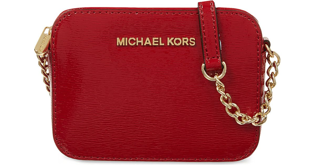 c5c26a35d3a0 MICHAEL Michael Kors Jet Set Travel Saffiano Patent-leather Crossbody Bag  Scarlet in Red - Lyst