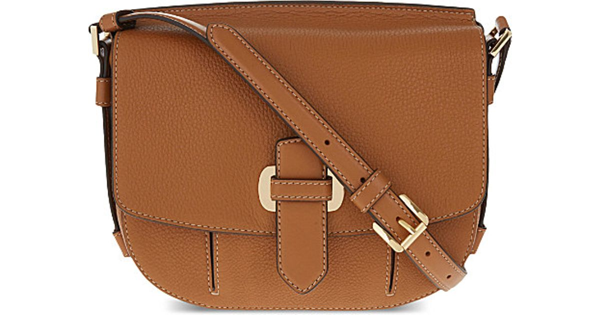 e2f82c3edde39d ... czech lyst michael michael kors romy medium pebbled leather messenger  in brown 6acf7 a5921