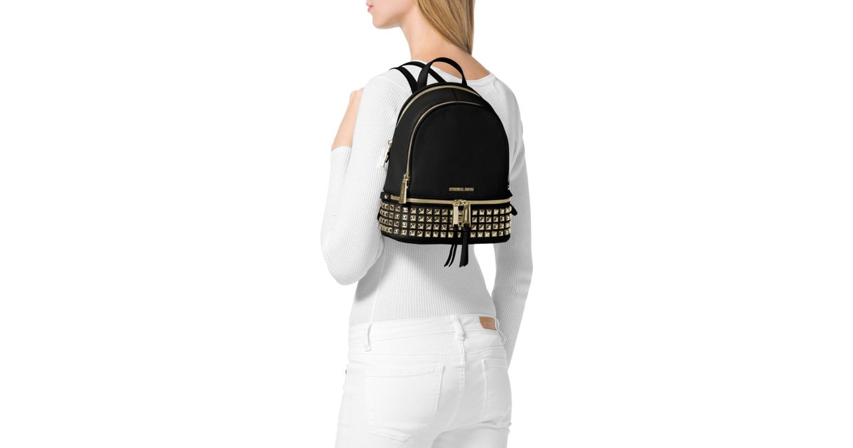 Lyst - MICHAEL Michael Kors Extra Small Rhea Zip Studded Backpack in Black 45c6a17e23e