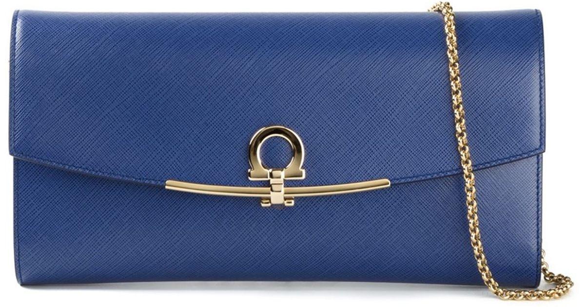 0f6c2773255d Lyst - Ferragamo Gancio Flap Clutch in Blue