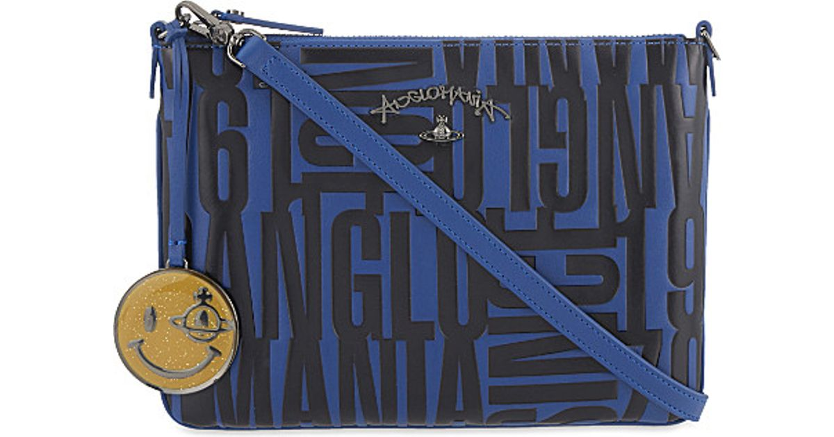 3d9db484717 Vivienne Westwood Anglomania Turner Text-embossed Cross Body Bag in Blue -  Lyst