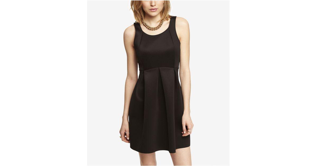 6ffc01a47b Lyst - Express Bonded Knit Criss Cross Back Babydoll Dress in Black