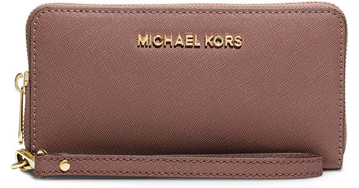 b30ba14f1a0f MICHAEL Michael Kors Jet Set Travel Saffiano Multifunction Tech Wristlet  Wallet in Brown - Lyst