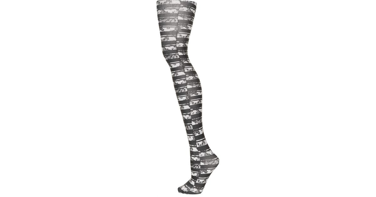 822ad4fa26f Lyst - TOPSHOP Floral Stripe Tights in Black