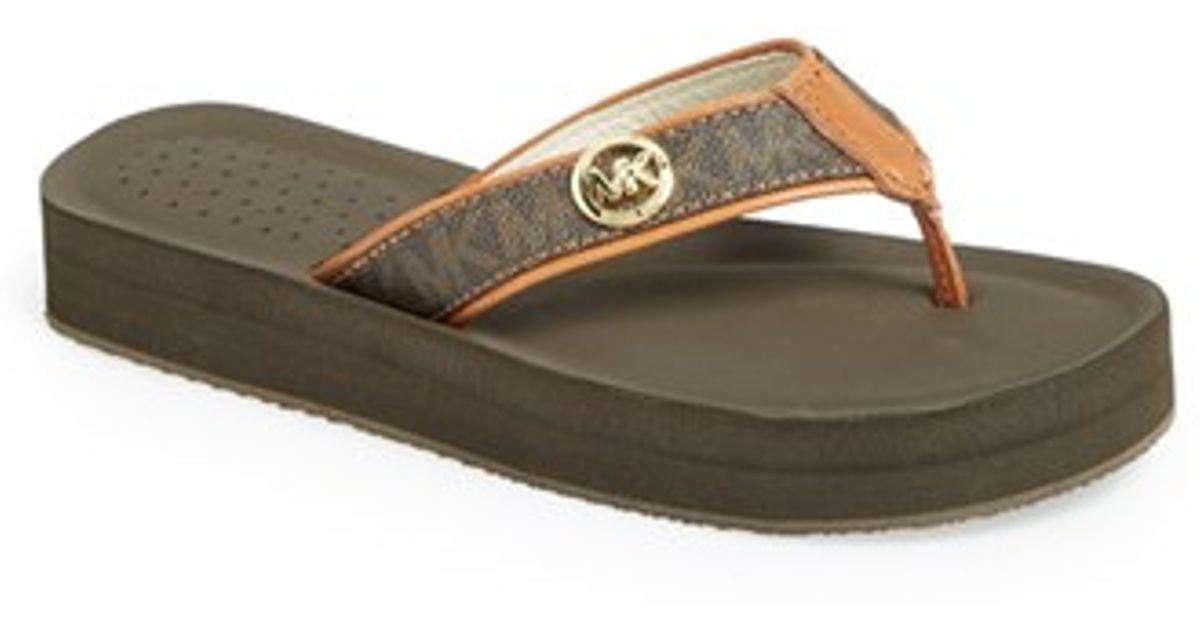 2e701a461a9973 Lyst - Michael Michael Kors  gage  Flip Flop in Brown