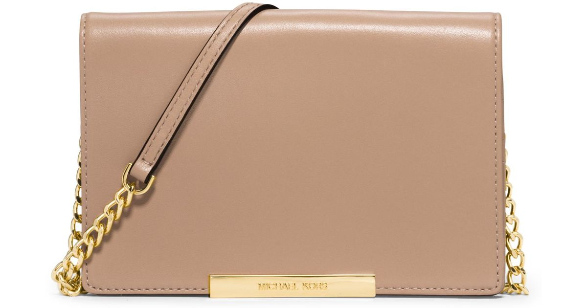 21e4d665a747f Lyst - Michael Kors Lana Leather Clutch in Natural