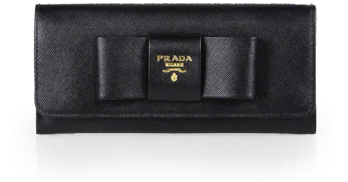 cf56e4b348c7 cheapest authentic prada saffiano bow wallet f0d54 fd899; get lyst prada  saffiano bow continental wallet in black 55b84 3791c
