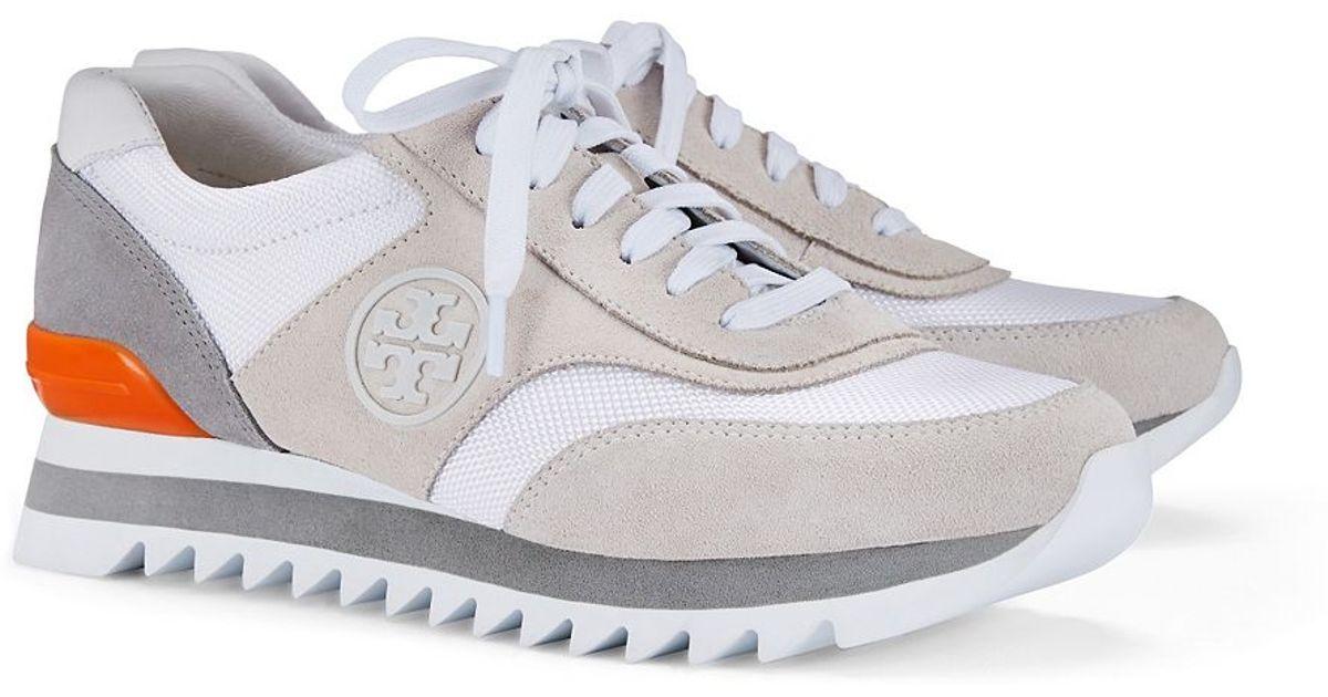 2c54fbed5af8 Lyst - Tory Burch Logo Sawtooth Sneaker in Gray