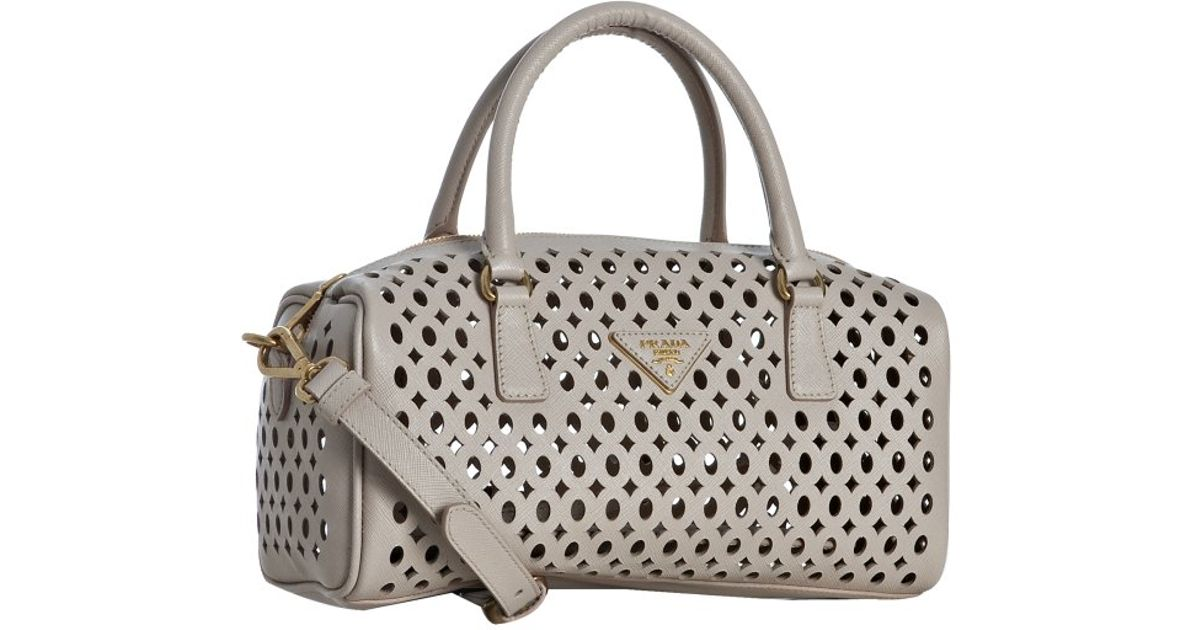 f252c095100c ... low price lyst prada powder pink saffiano leather eyelet top handle bag  in natural 95697 a93c3