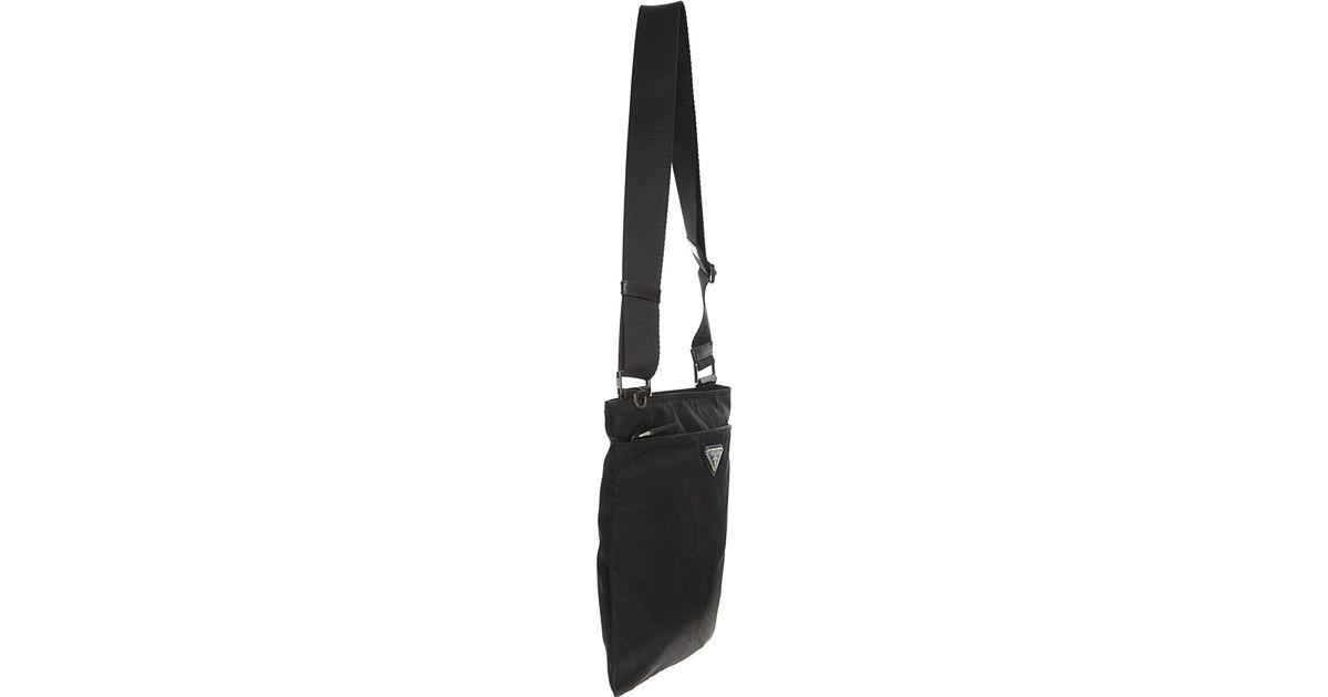 fa29191728b8 ... discount code for prada vela flat messenger bag in black lyst 8efef  304ea