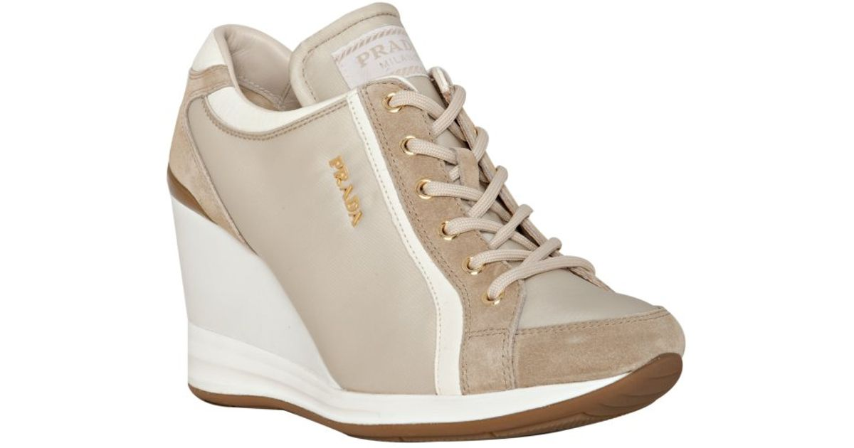 368680d2663 ... low price lyst prada sport ivory nylon suede trim wedge sneakers in  white c26db 15f04