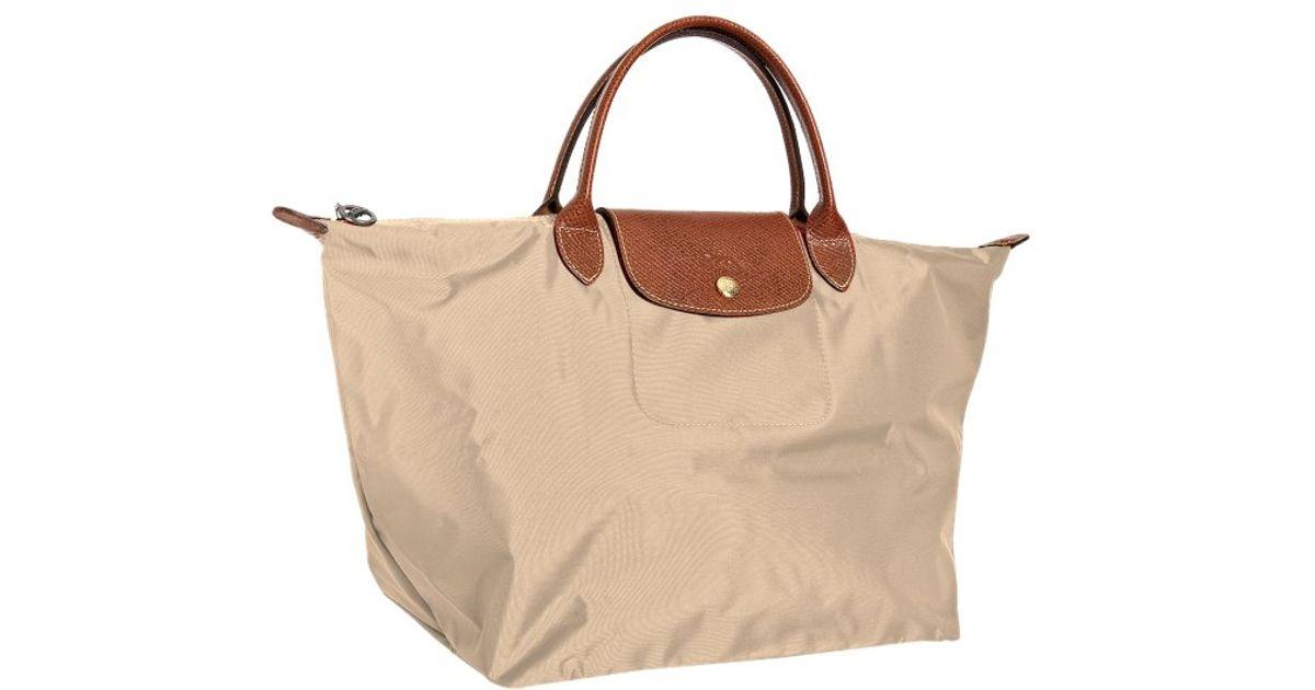 designer outlet gray sambas u6al  longchamp folding tote bag
