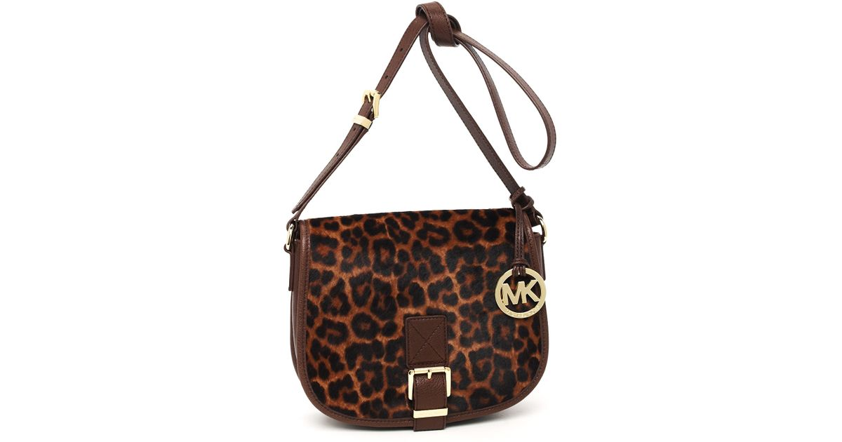 9e2e6840f1f899 ... switzerland lyst michael michael kors medium saddle bag messenger  leopard print a7b16 7516d