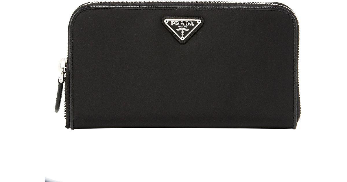 0e2813da51fd Prada Tessuto Side-zip Wallet in Black - Lyst