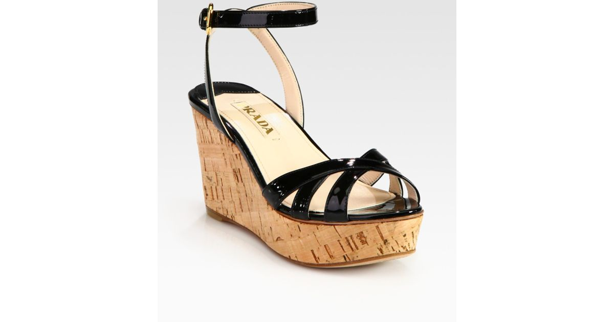 0050b6211e45 Lyst - Prada Patent Leather and Cork Ankle Strap Wedge Sandals in Natural