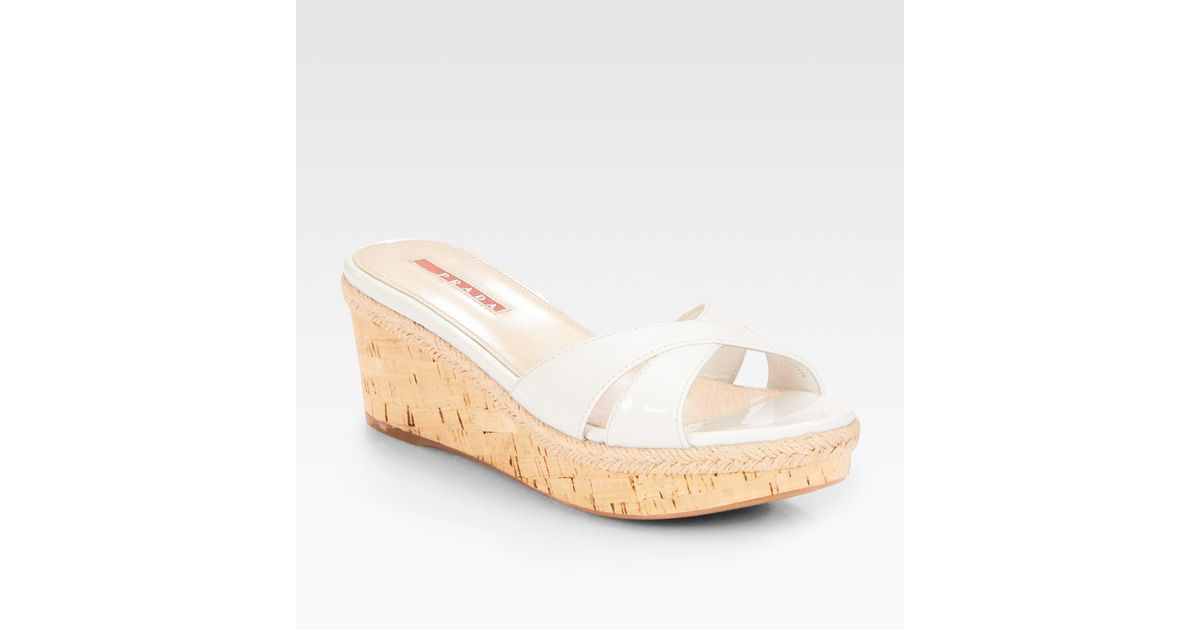 9cf168e7edfe8 Lyst - Prada Patent Leather Cork Wedge Slides in White