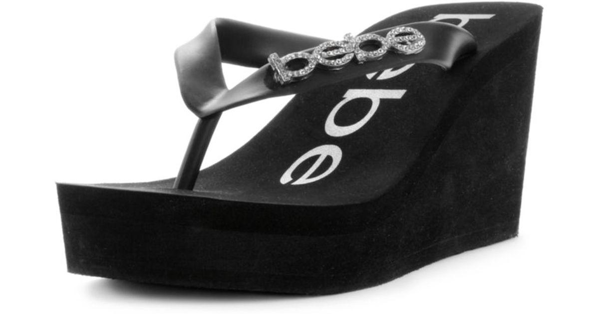 a2ac3d869a0 Lyst - Bebe Kristy Wedge Flip Flop Sandals in Black