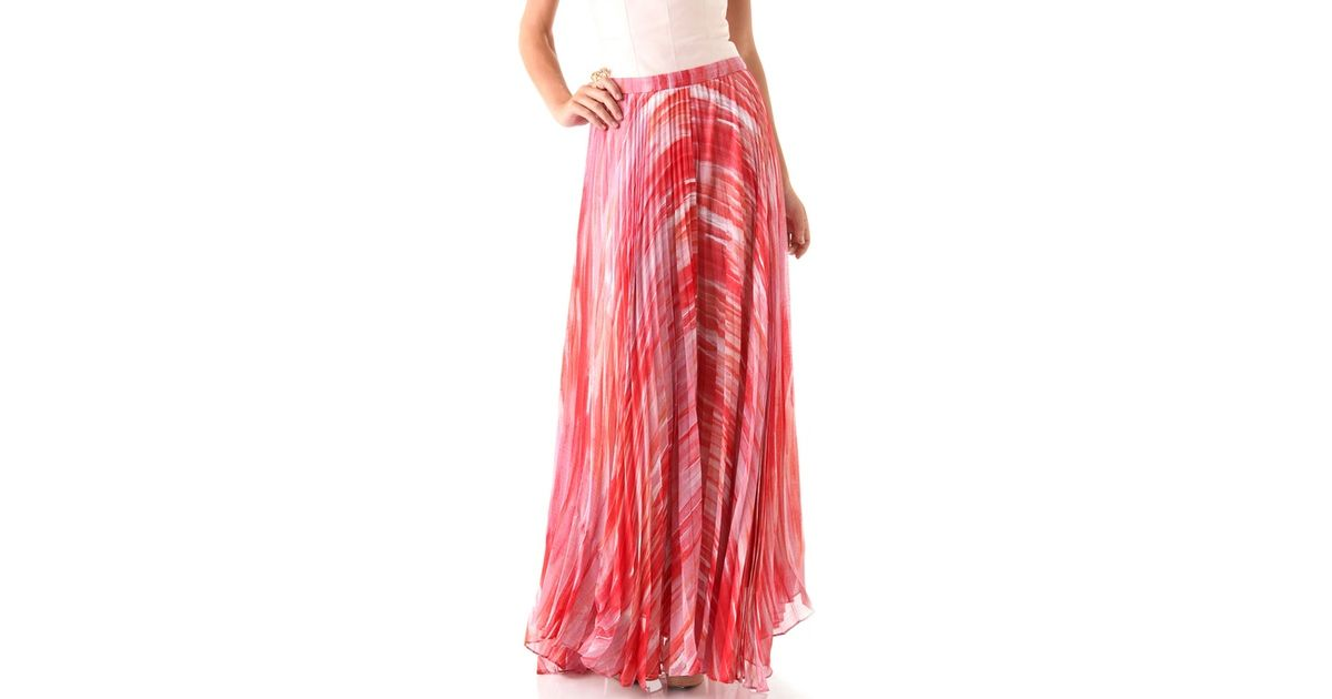 shannon pleated maxi skirt in orange lyst