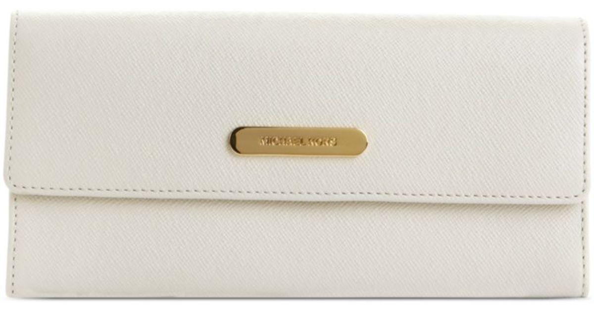 913c68399fd3 Lyst - Michael Kors Saffiano Large Slim Flap Wallet in White