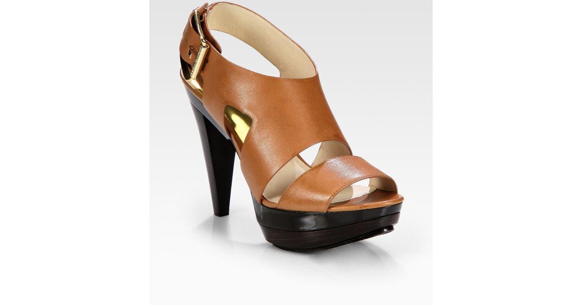 4f9b7ff90958 Lyst - MICHAEL Michael Kors Carla Leather Platform Sandals in Brown