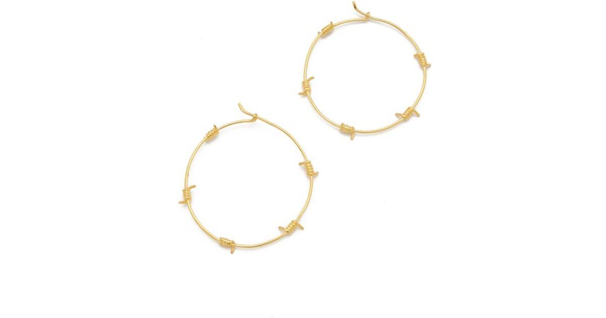 Lyst - Tom Binns Barricade Babe Barb Wire Hoop Earrings in Metallic