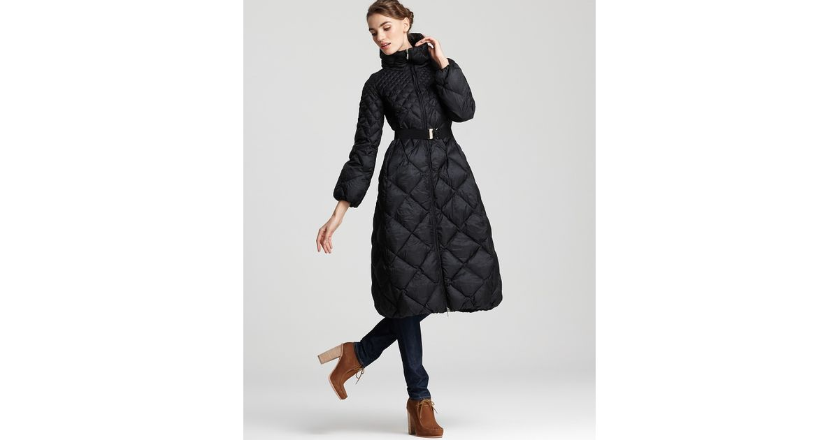 4299cf3be34d Lyst - Moncler Carcajou Long Quilted Down Coat in Black