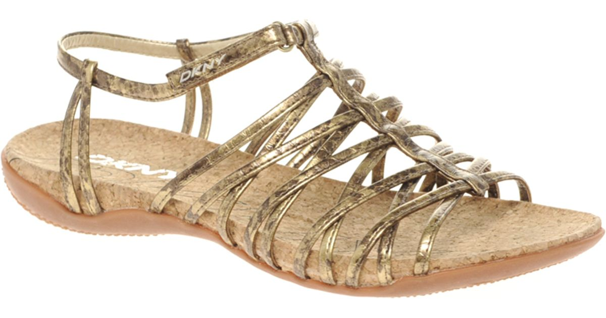 e119fc7a7774a Lyst - DKNY Active Kallipso Strappy Flat Sandals in Metallic