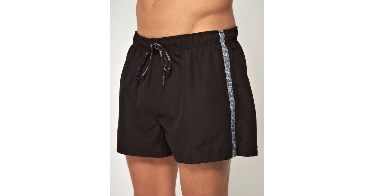 637b13fb36 Calvin Klein Logo Tape Swim Shorts in Black for Men - Lyst