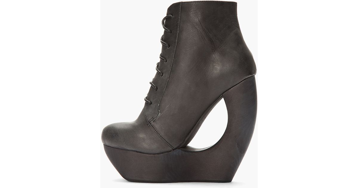 e83941b7881c Lyst - Jeffrey Campbell Black Leather Cutout Roxie Wedge Boots in Black