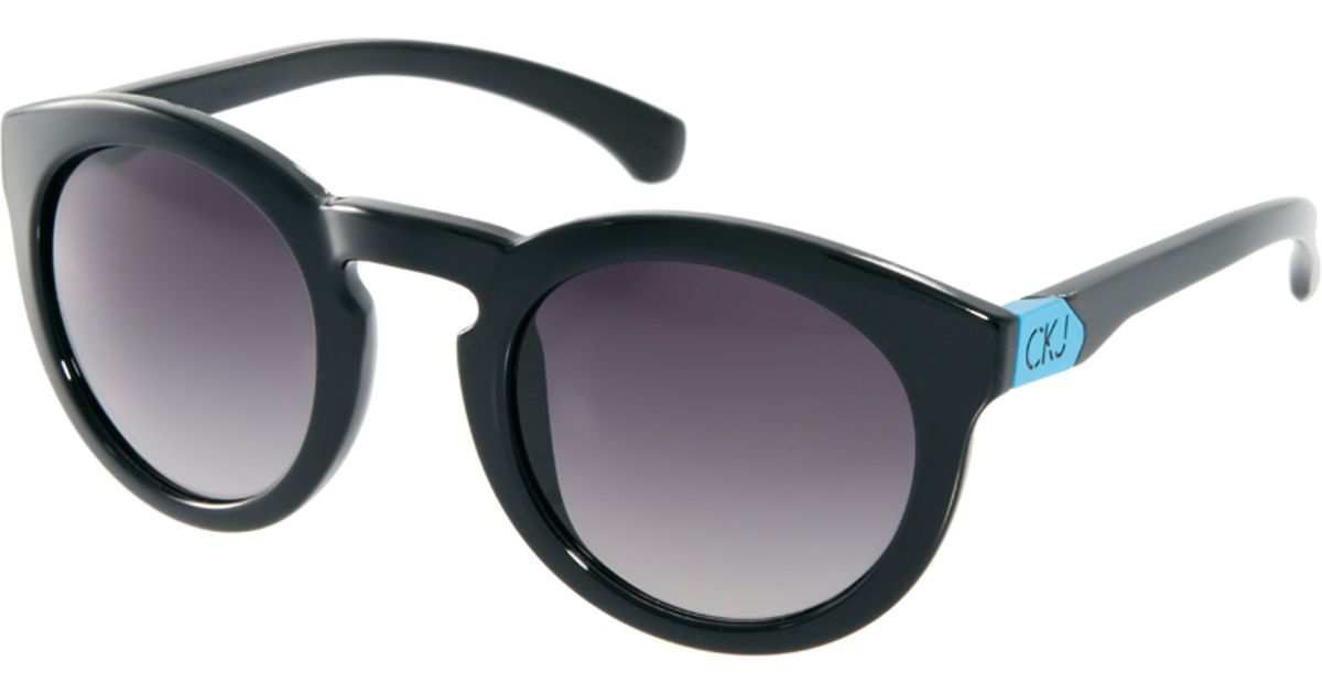 67603b8c1 Calvin Klein Round Sunglasses in Black for Men - Lyst