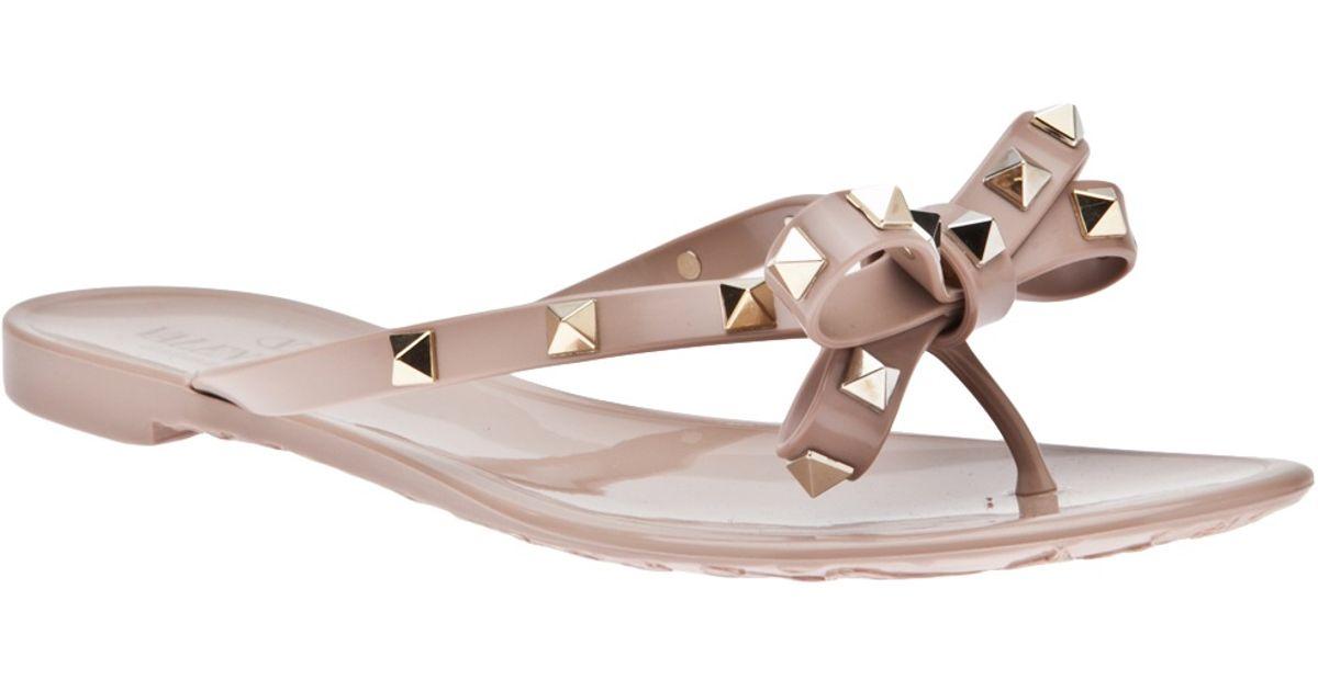 5686f89f87b8 Valentino Rockstud Bow Sandals in Natural - Lyst