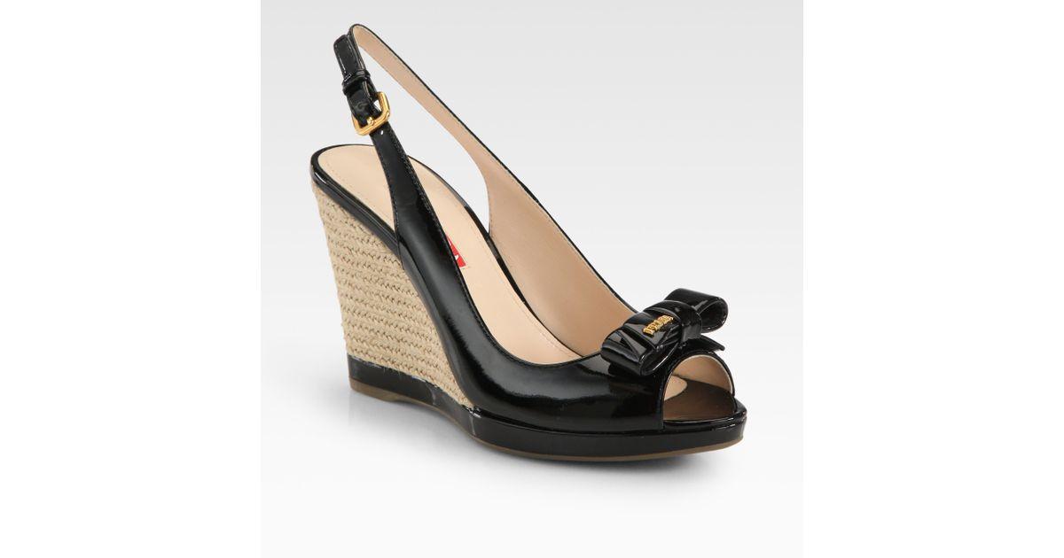 bcdd9b792ce Prada - Black Patent Leather Bow Espadrille Wedge Sandals - Lyst
