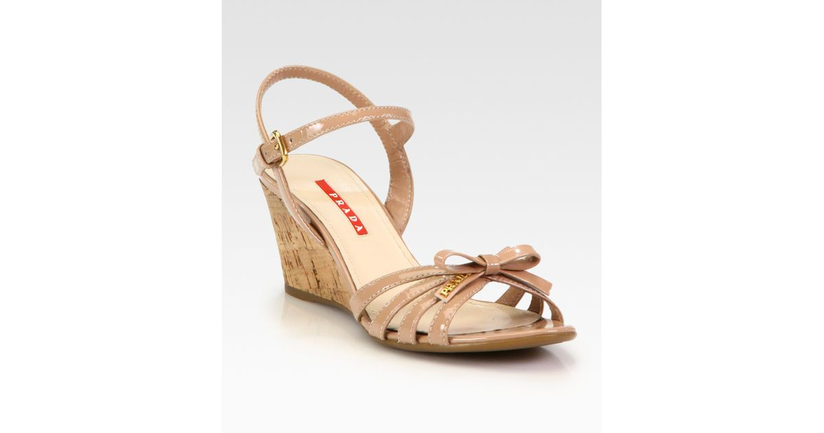 d0026dc9e31 Lyst - Prada Leather Bow Cork Wedge Sandals in Natural