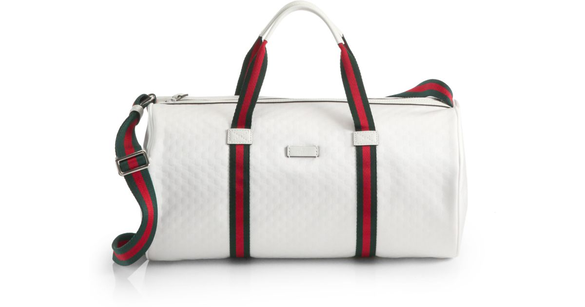 Lyst - Gucci Leathertrimmed Logoembossed Nylon Duffel Bag in White for Men