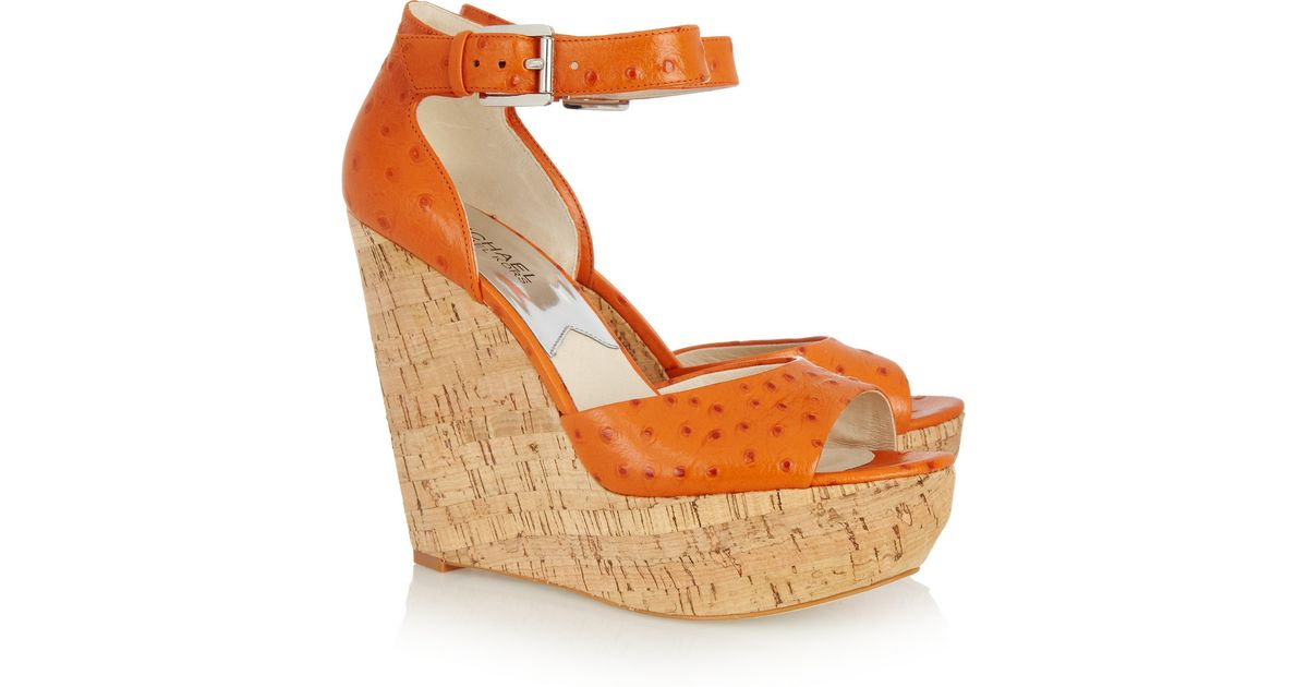 02b6fa79d6b Lyst - MICHAEL Michael Kors Ariana Ostrich-effect Leather Wedge Sandals in  Orange