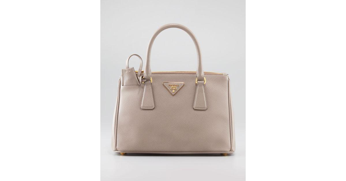 a1c7373f2e ... low price lyst prada mini saffiano lux tote bag in pink 706da 897c9