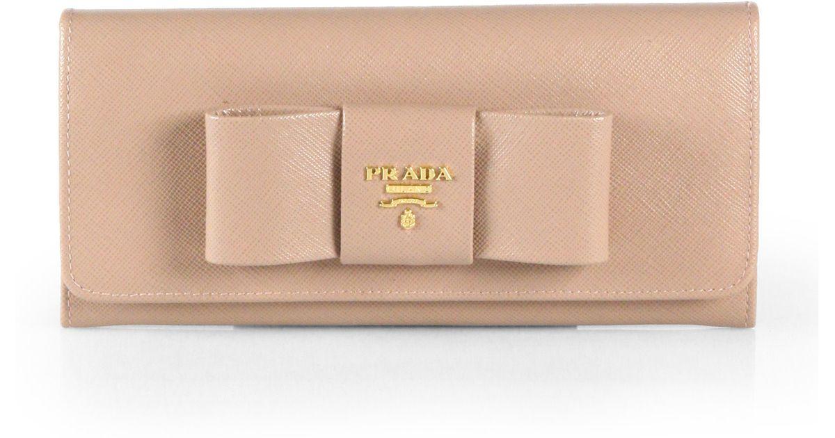 44cb51f5d5e1d1 wholesale prada saffiano bow continental wallet 0250d 1af99