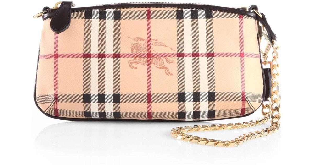 469f336d2424 Lyst - Burberry Clara Haymarket Coated Canvas Wristlet in Pink